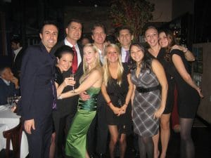 Image of Doctor Miller and his team posing for a photo at a party, New York, NY