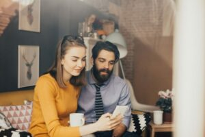 stock photo of man and a woman at a cafe for a blog about what to expect after a facelift surgery in NYC, NY