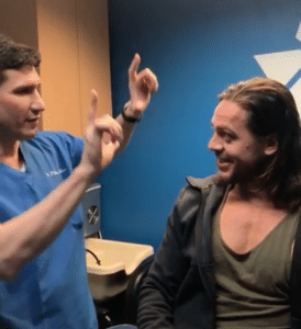 """Dr. Philip Miller in his New York Rhinoplasty Office Talks to """"Aquaman""""."""